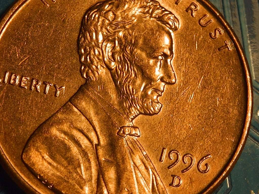 Click to get the codes for this image. Lincoln Penny Close Up, Money and Coins Background, wallpaper or texture for, Blogger, Wordpress, or any web page, blog, desktop or phone.