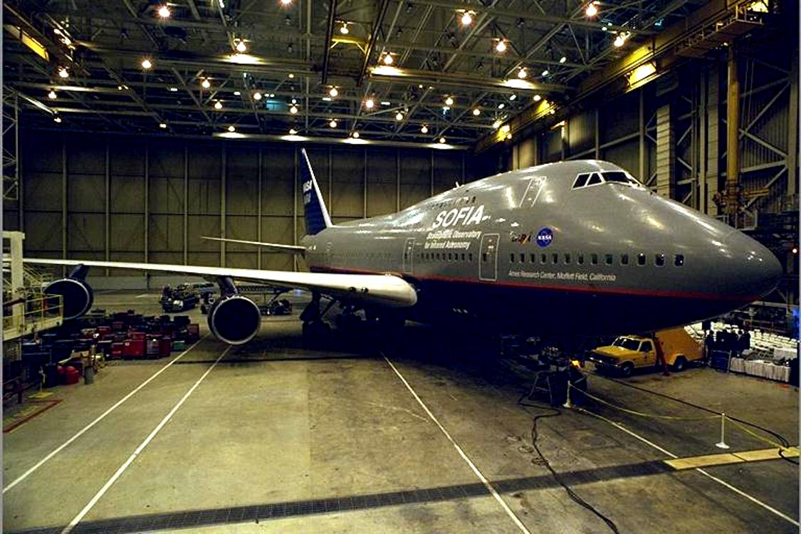 Click to get the codes for this image. Nasa Jet Liner In Hangar, Airplanes  Rockets Background, wallpaper or texture for any blog, web page, phone or desktop