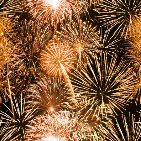 orange fireworks tiled background wallpaper