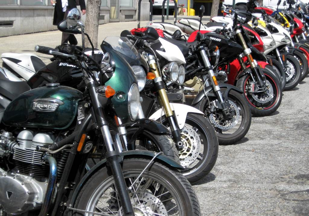 Click to get the codes for this image. Parked Motorcycles, Cars Boats Trains etc Background, wallpaper or texture for any blog, web page, phone or desktop