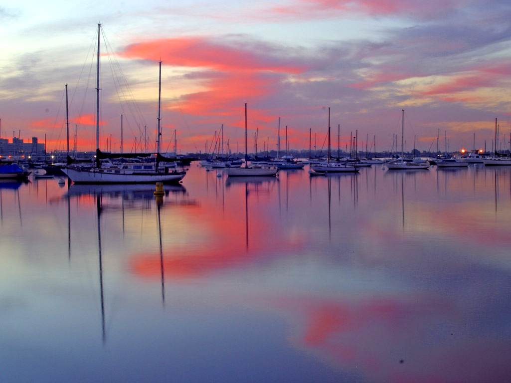 Click to get the codes for this image. Sailboats At Sunset, Cars Boats Trains etc, Sunsets and Sunrises, Ocean  Water Background, wallpaper or texture for any blog, web page, phone or desktop