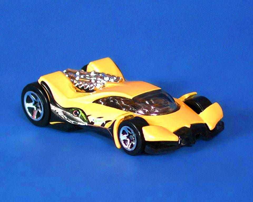 Click to get the codes for this image. Yellow Hot Wheels Toy Car, Cars Boats Trains etc Background, wallpaper or texture for any blog, web page, phone or desktop