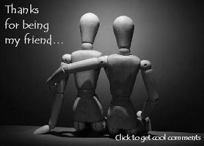 Click to get the codes for this image. This photo shows two wooden dolls one with its arm around the other. The comment reads: Thanks for being my friend...