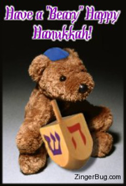 Click to get the codes for this image. Cute photo of a teddy bear wearing a blue yamaka and holding a wooden dradle. The comment reads: Have a Beary Happy Hanukkah!